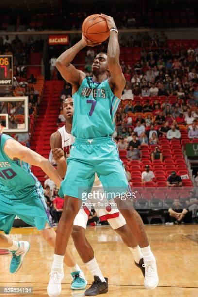 Dwayne Bacon of the Charlotte Hornets shoots the ball against the Miami Heat during the preseason game on October 9 2017 at American Airlines Arena...
