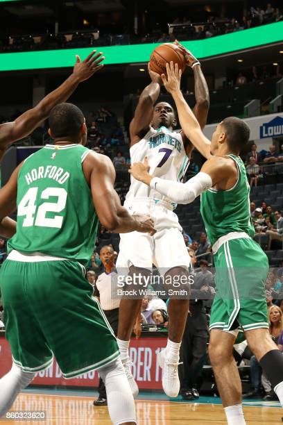 Dwayne Bacon of the Charlotte Hornets shoots the ball against the Boston Celtics on October 11 2017 at Spectrum Center in Charlotte North Carolina...
