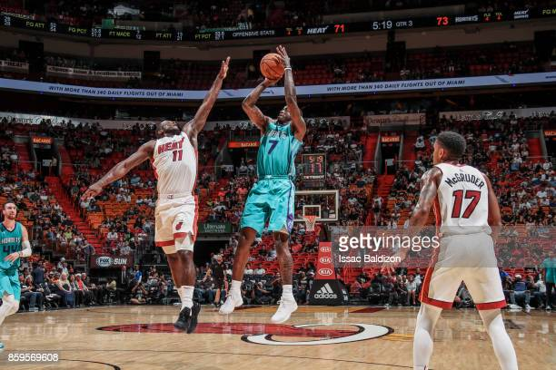 Dwayne Bacon of the Charlotte Hornets shoots the ball during the preseason game against the Miami Heat on October 9 2017 at AmericanAirlines Arena in...
