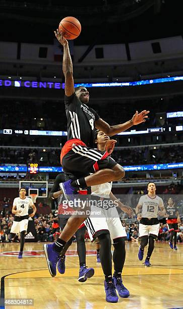 Dwayne Bacon of the East team goes up for a shot past Deyonta Davis of the west team during the 2015 McDonalds's All American Game at the United...
