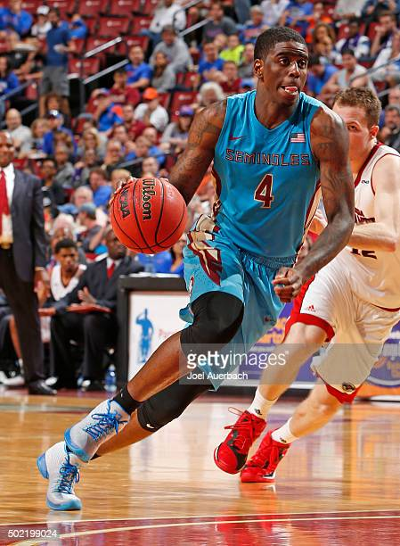 Dwayne Bacon of the Florida State Seminoles dribbles the ball against the Florida Atlantic Owls during the MetroPCS Orange Bowl Basketball Classic on...