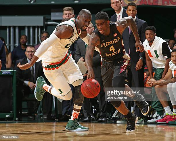 Dwayne Bacon of the Florida State Seminoles dribbles the ball against Tonye Jekiri of the Miami Hurricanes on January 9 2016 at the BankUnited Center...