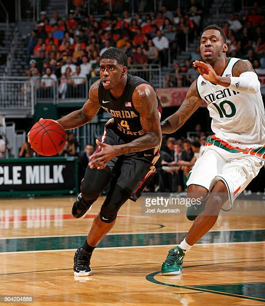 Dwayne Bacon of the Florida State Seminoles dribbles to the basket against Sheldon McClellan of the Miami Hurricanes on January 9 2016 at the...