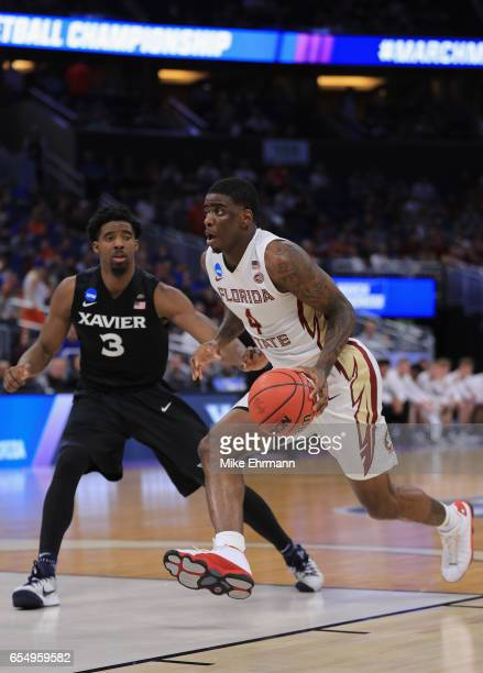 Dwayne Bacon of the Florida State Seminoles drives against Quentin Goodin of the Xavier Musketeers in the second half during the second round of the...