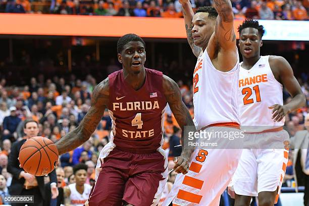 Dwayne Bacon of the Florida State Seminoles drives to the basket past DaJuan Coleman of the Syracuse Orange during the first half at the Carrier Dome...