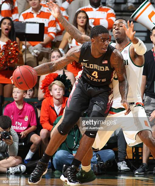 Dwayne Bacon of the Florida State Seminoles drives to the basket against the Miami Hurricanes on January 9 2016 at the BankUnited Center in Coral...