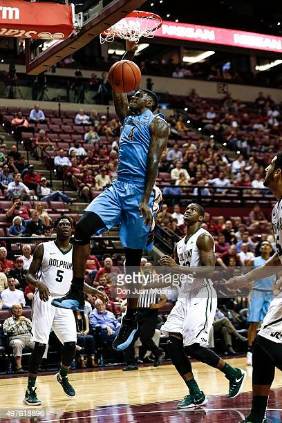 Dwayne Bacon of the Florida State Seminoles dunk the ball during the game against the Jacksonville Dolphins at the Donald L Tucker Center on November...