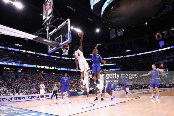 Dwayne Bacon of the Florida State Seminoles dunks the ball in the first half against the Florida Gulf Coast Eagles during the first round of the 2017...