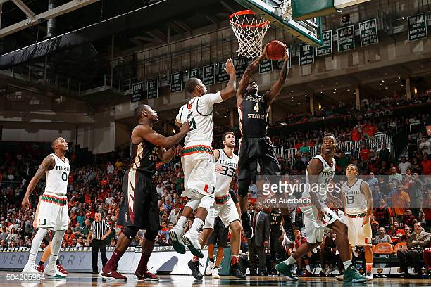 Dwayne Bacon of the Florida State Seminoles goes to the basket against Kamari Murphy of the Miami Hurricanes on January 9 2016 at the BankUnited...