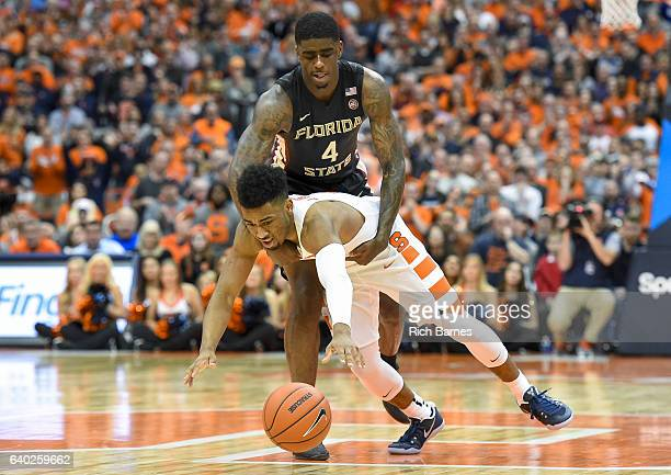 Dwayne Bacon of the Florida State Seminoles grabs John Gillon of the Syracuse Orange for a foul call during the second half at the Carrier Dome on...