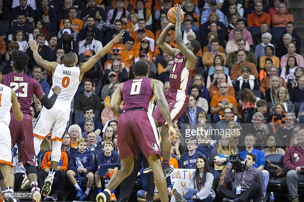 Dwayne Bacon of the Florida State Seminoles makes a jump shot over Devon Hall of the Virginia Cavaliers during a game at John Paul Jones Arena on...