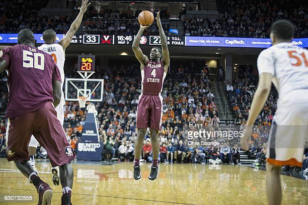 Dwayne Bacon of the Florida State Seminoles makes a three point shot during Florida's game against the Virginia Cavaliers at John Paul Jones Arena on...