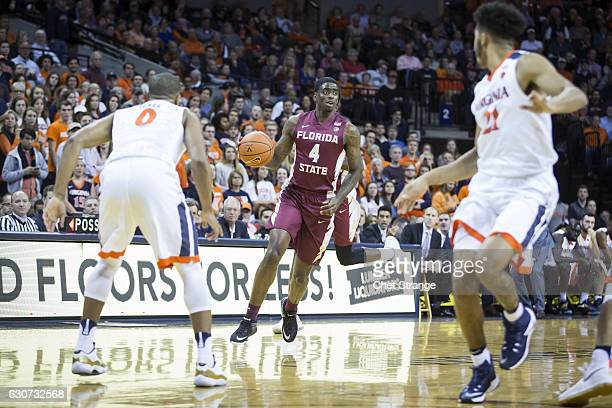 Dwayne Bacon of the Florida State Seminoles moves the ball during Florida's game against the Virginia Cavaliers at John Paul Jones Arena on December...