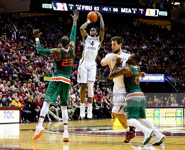 Dwayne Bacon of the Florida State Seminoles shoots over Tonye Jekiri of the Miami Hurricanes during the game at the Donald L Tucker Center on...