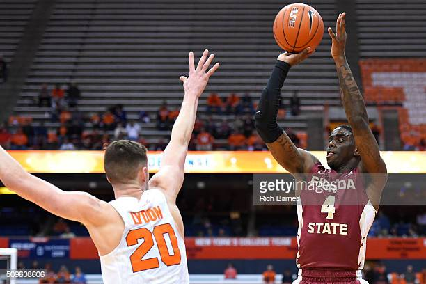 Dwayne Bacon of the Florida State Seminoles shoots the ball against the defense of Tyler Lydon of the Syracuse Orange during the first half at the...