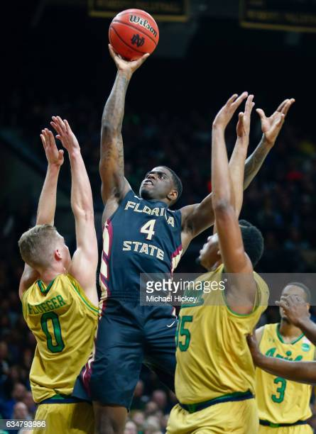 Dwayne Bacon of the Florida State Seminoles shoots the ball over Rex Pflueger of the Notre Dame Fighting Irish at Purcell Pavilion on February 11...