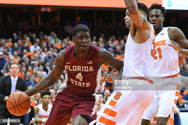 Dwayne Bacon of the Florida State Seminoles shoots the ball past DaJuan Coleman of the Syracuse Orange during the first half at the Carrier Dome on...