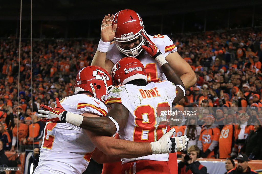 <a gi-track='captionPersonalityLinkClicked' href=/galleries/search?phrase=Dwayne+Bowe&family=editorial&specificpeople=2139865 ng-click='$event.stopPropagation()'>Dwayne Bowe</a> #82 of the Kansas City Chiefs celebrates his second quarter touchdown against the Denver Broncos with teammates at Sports Authority Field at Mile High on November 17, 2013 in Denver, Colorado.