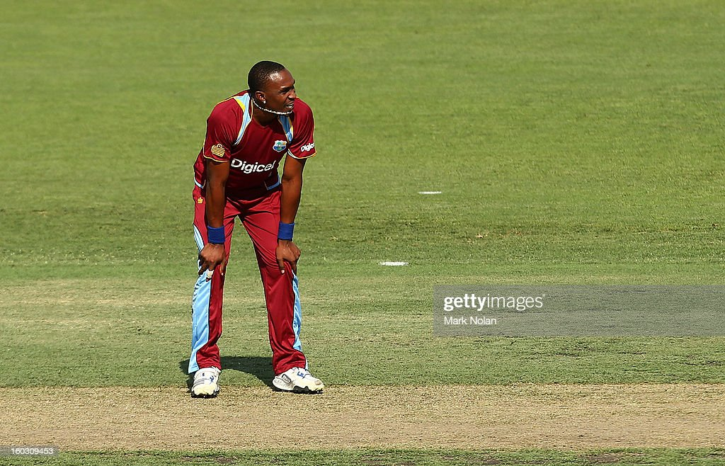 Dwayne Bravio of the West Indies reacts after a delivery during the International Tour Match between the Prime Minister's XI and West Indies at Manuka Oval on January 29, 2013 in Canberra, Australia.