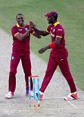Dwayne Bravo and Darren Sammy of West Indies celebrates the wicket of Freddie Coleman of Birmingham Bears during the T20 match between Birmingham...
