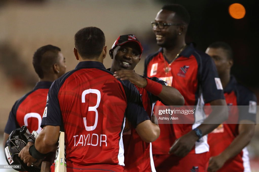 Dwayne Bravo congratulates Ross Taylor after winning a match between St. Lucia Zouks and The Red Steel as part of week 4 of the Limacol Caribbean Premier League 2014 at Beausejour Stadium on August 02, 2014 in Castries, St. Lucia.