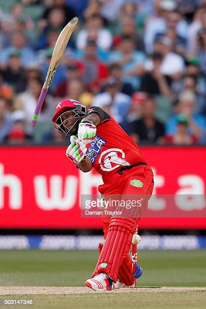 Dwayne Bravo of the Melbourne Renegades losers grip of his bat as his stumps are smashed by a delivery from John Hastings of the Melbourne Stars...