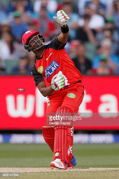 Dwayne Bravo of the Melbourne Renegades watches his bat fly through the air as his stumps are smashed by a John Hastings of the Melbourne Stars...