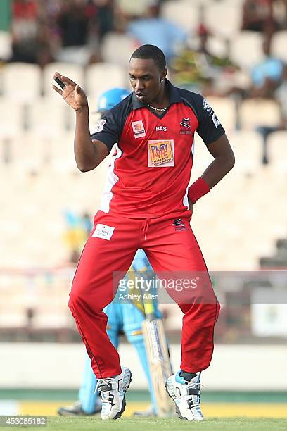 Dwayne Bravo of The Red Steel dances after getting a wicket during a match between St Lucia Zouks and The Trinidad and Tobago Red Steel as part of...