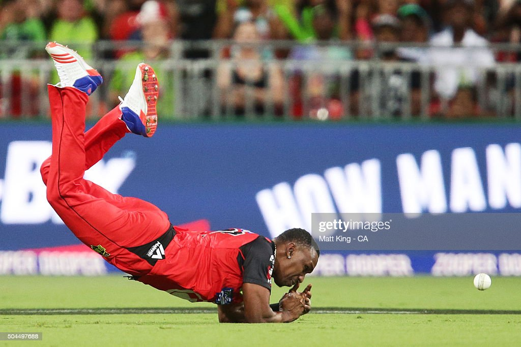 Dwayne Bravo of the Renegades drops a catching chance for the wicket of Shane Watson of the Thunder during the Big Bash League match between the Sydney Thunder and the Melbourne Renegades at Spotless Stadium on January 11, 2016 in Sydney, Australia.
