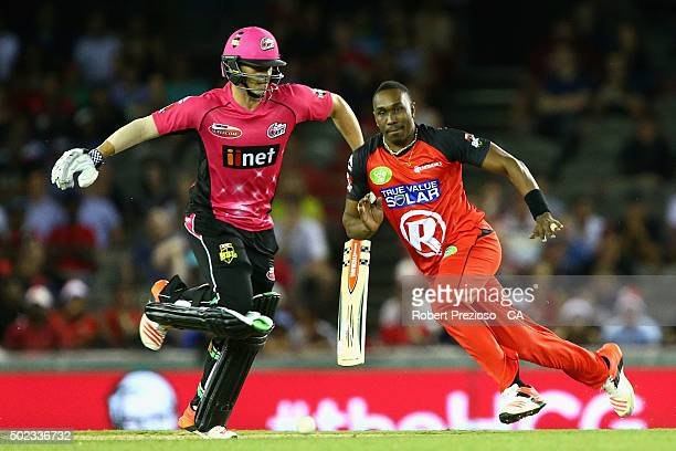 Dwayne Bravo of the renegades fields the ball during the Big Bash League match between the Melbourne Renegades and the Sydney Sixers at Etihad...