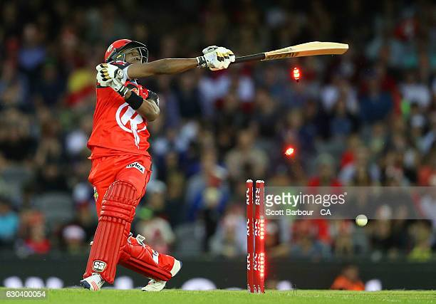 Dwayne Bravo of the Renegades loses grip of his bat as he is bowled out during the Big Bash League match between the Melbourne Renegades and Sydney...