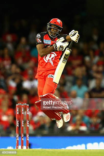 Dwayne Bravo of the Renegades plays a shot during the Big Bash League match between the Melbourne Renegades and Sydney Thunder at Etihad Stadium on...