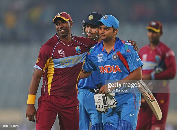 Dwayne Bravo of the West Indies and Suresh Raina of India embrace after the ICC World Twenty20 Bangladesh 2014 match between the West Indies and...