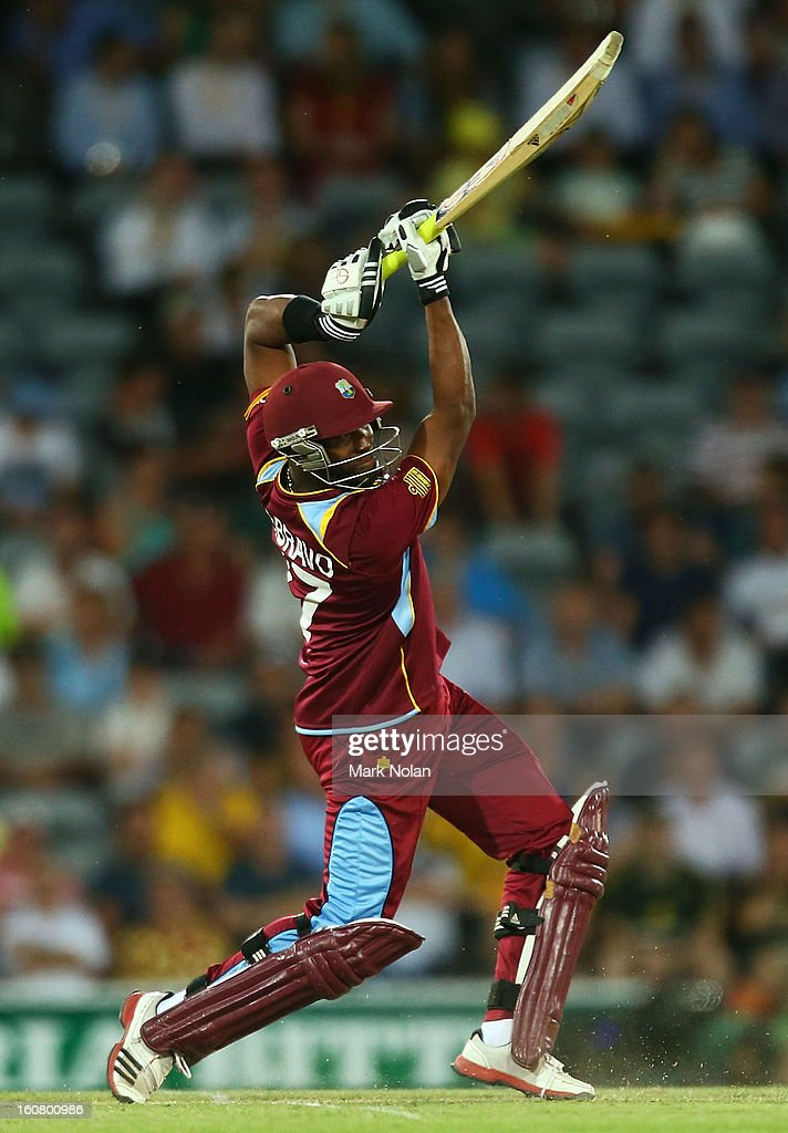 <a gi-track='captionPersonalityLinkClicked' href=/galleries/search?phrase=Dwayne+Bravo&family=editorial&specificpeople=178945 ng-click='$event.stopPropagation()'>Dwayne Bravo</a> of the West Indies bats during the Commonwealth Bank One Day International Series between Australia and the West Indies at Manuka Oval on February 6, 2013 in Canberra, Australia.