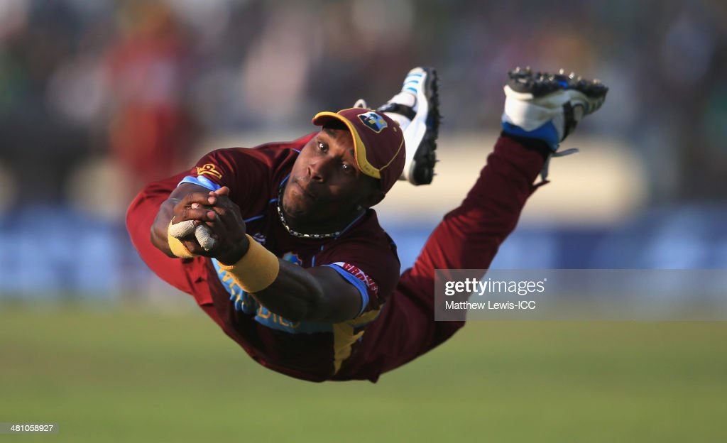 <a gi-track='captionPersonalityLinkClicked' href=/galleries/search?phrase=Dwayne+Bravo&family=editorial&specificpeople=178945 ng-click='$event.stopPropagation()'>Dwayne Bravo</a> of the West Indies catches James Faulkner of Australia off the bowling of Krishmar Santokie during the ICC World Twenty20 Bangladesh 2014 match between the West indies and Australia at Sher-e-Bangla Mirpur Stadium on March 28, 2014 in Dhaka, Bangladesh.