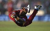 Dwayne Bravo of the West Indies catches James Faulkner of Australia off the bowling of Krishmar Santokie during the ICC World Twenty20 Bangladesh...