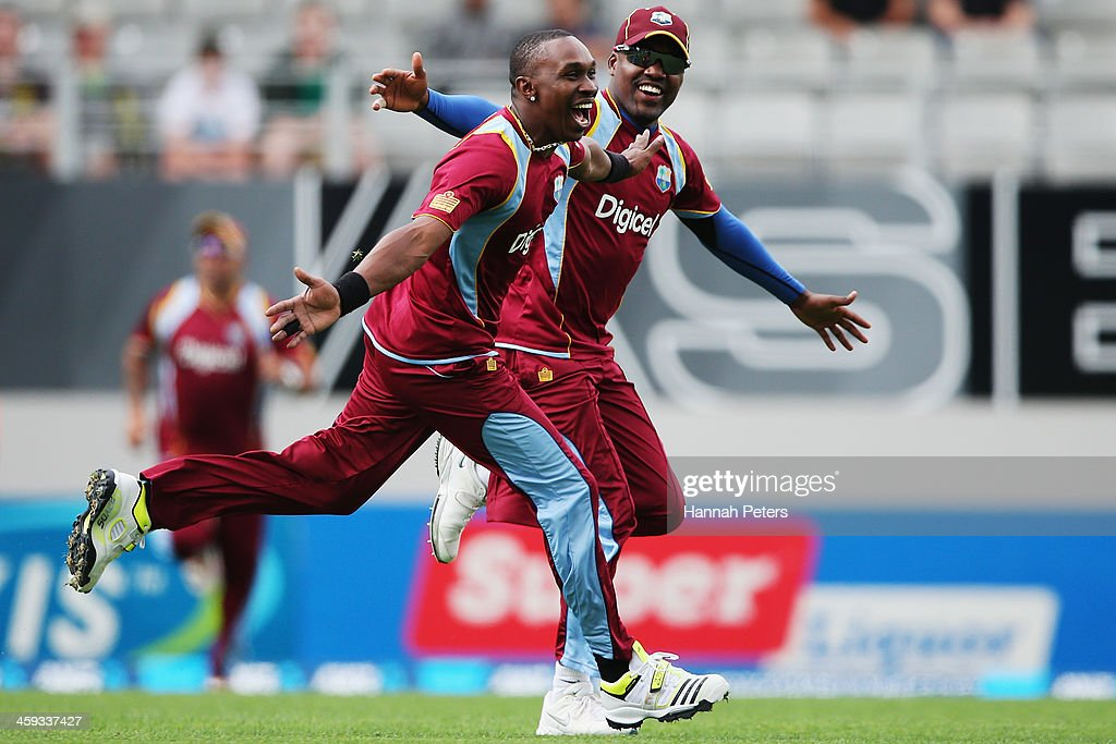 <a gi-track='captionPersonalityLinkClicked' href=/galleries/search?phrase=Dwayne+Bravo&family=editorial&specificpeople=178945 ng-click='$event.stopPropagation()'>Dwayne Bravo</a> of the West Indies celebrates a lbw decision which was later overturned with <a gi-track='captionPersonalityLinkClicked' href=/galleries/search?phrase=Darren+Bravo&family=editorial&specificpeople=4884685 ng-click='$event.stopPropagation()'>Darren Bravo</a> during the first One Day International match between New Zealand and the West Indies at Eden Park on December 26, 2013 in Auckland, New Zealand.