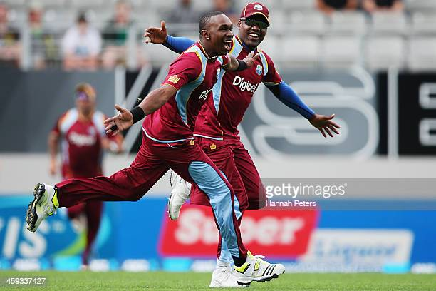 Dwayne Bravo of the West Indies celebrates a lbw decision which was later overturned with Darren Bravo during the first One Day International match...