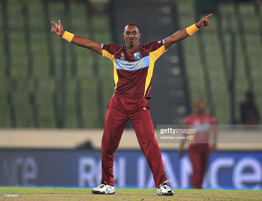 <a gi-track='captionPersonalityLinkClicked' href=/galleries/search?phrase=Dwayne+Bravo&family=editorial&specificpeople=178945 ng-click='$event.stopPropagation()'>Dwayne Bravo</a> of the West Indies celebrates bowling Sachithra Senanayake of Sri Lanka during the ICC World Twenty20 Bangladesh 2014 Warm Up match between Sri Lanka and West Indies at Shere Bangla National Stadium on March 19, 2014 in Dhaka, Bangladesh.