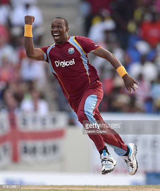 Dwayne Bravo of the West Indies celebrates catching and bowling Joe Root of England during the 2nd One Day International between the West Indies and...