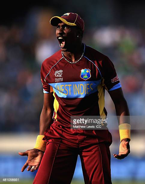 Dwayne Bravo of the West Indies celebrates catching James Faulkner of Australia off the bowling of Krishmar Santokie during the ICC World Twenty20...