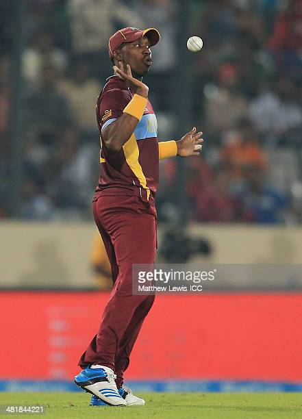 Dwayne Bravo of the West Indies celebrates catching Kamran Akmal of Pakistan off the bowling of samue Badree during the ICC World Twenty20 Bangladesh...