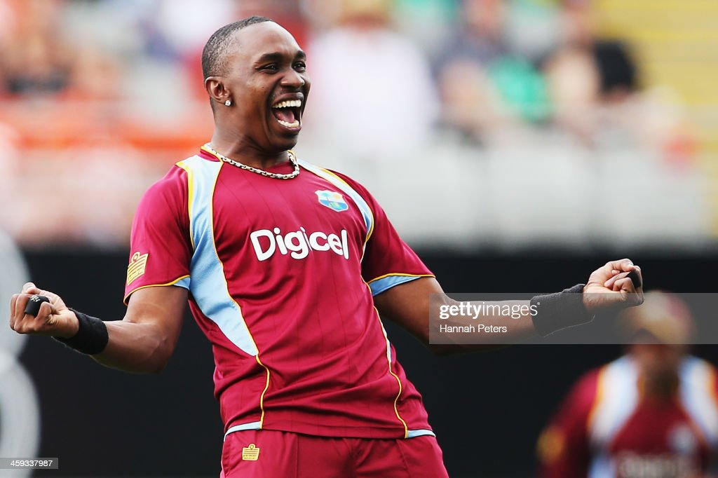 <a gi-track='captionPersonalityLinkClicked' href=/galleries/search?phrase=Dwayne+Bravo&family=editorial&specificpeople=178945 ng-click='$event.stopPropagation()'>Dwayne Bravo</a> of the West Indies celebrates the wicket of Brendon McCullum of New Zealand during the first One Day International match between New Zealand and the West Indies at Eden Park on December 26, 2013 in Auckland, New Zealand.