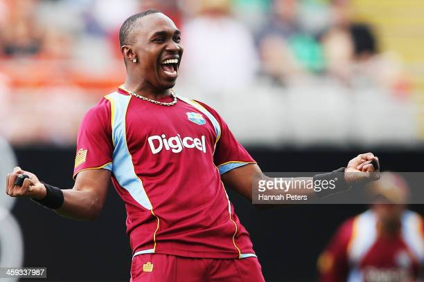 Dwayne Bravo of the West Indies celebrates the wicket of Brendon McCullum of New Zealand during the first One Day International match between New...