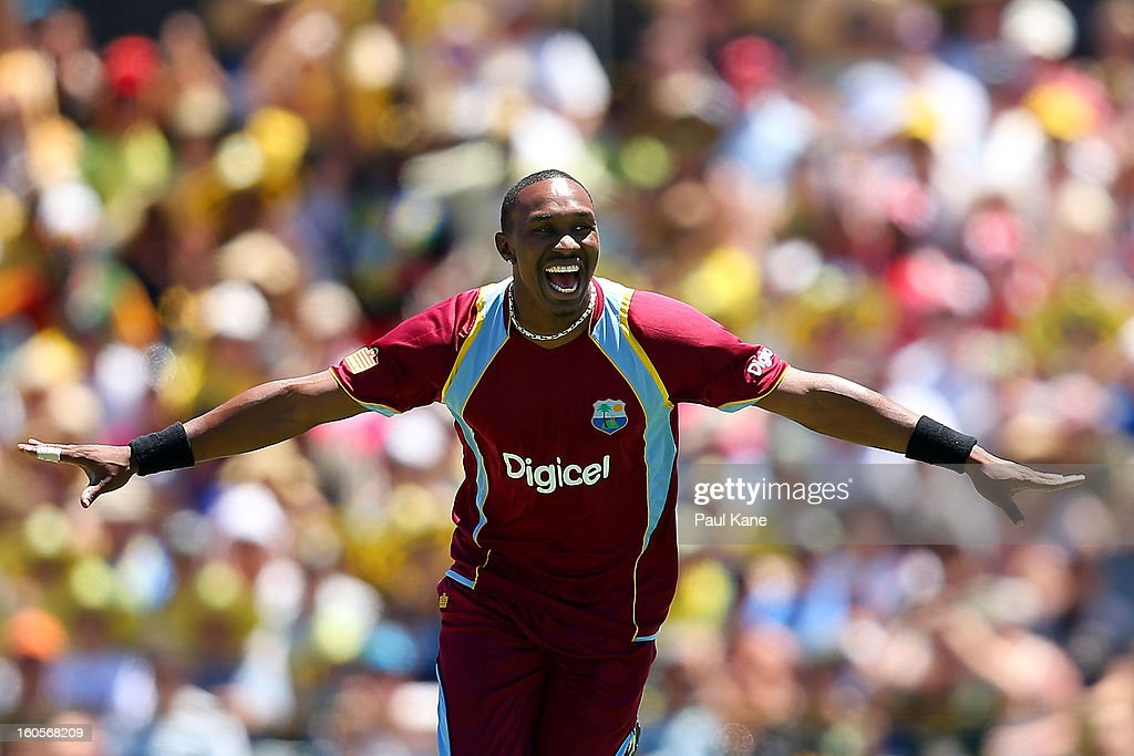 <a gi-track='captionPersonalityLinkClicked' href=/galleries/search?phrase=Dwayne+Bravo&family=editorial&specificpeople=178945 ng-click='$event.stopPropagation()'>Dwayne Bravo</a> of the West Indies celebrates the wicket of Michael Clarke of Australia during game two of the Commonwealth Bank One Day International Series between Australia and the West Indies at WACA on February 3, 2013 in Perth, Australia.