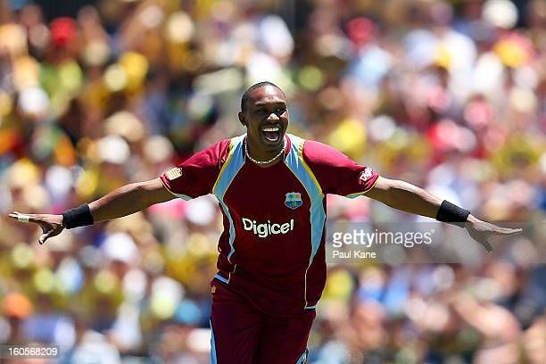 Dwayne Bravo of the West Indies celebrates the wicket of Michael Clarke of Australia during game two of the Commonwealth Bank One Day International...