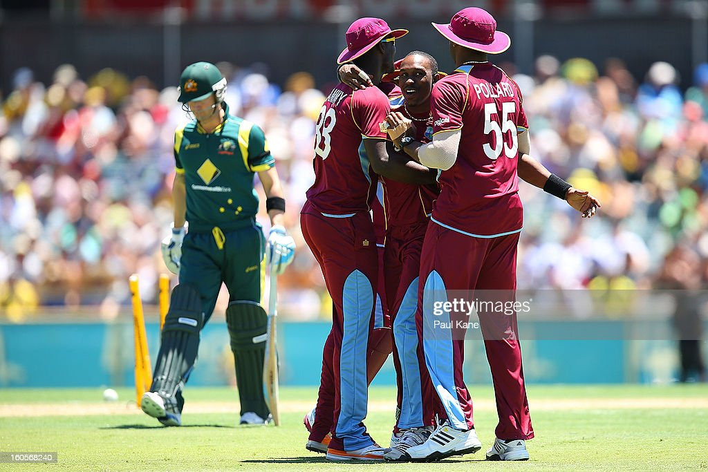 <a gi-track='captionPersonalityLinkClicked' href=/galleries/search?phrase=Dwayne+Bravo&family=editorial&specificpeople=178945 ng-click='$event.stopPropagation()'>Dwayne Bravo</a> of the West Indies celebrates the wicket of Michael Clarke of Australia with Darren Sammy and Kieron Pollard during game two of the Commonwealth Bank One Day International Series between Australia and the West Indies at WACA on February 3, 2013 in Perth, Australia.
