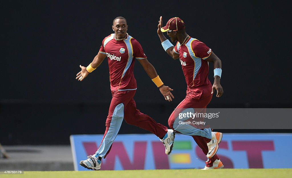 <a gi-track='captionPersonalityLinkClicked' href=/galleries/search?phrase=Dwayne+Bravo&family=editorial&specificpeople=178945 ng-click='$event.stopPropagation()'>Dwayne Bravo</a> of the West Indies celebrates with <a gi-track='captionPersonalityLinkClicked' href=/galleries/search?phrase=Darren+Sammy&family=editorial&specificpeople=2920912 ng-click='$event.stopPropagation()'>Darren Sammy</a> after dismissing Ben Stokes of England during the 3rd One Day International between the West Indies and England at Sir Viv Richards Cricket Ground on March 5, 2014 in Antigua, Antigua and Barbuda.