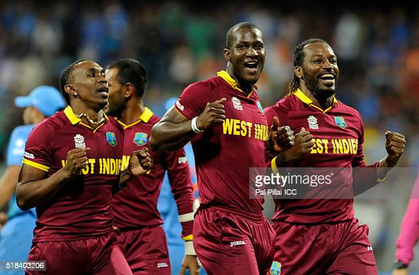 Dwayne Bravo of the West Indies Darren Sammy Captain of the West Indies and Chris Gayle of the West Indies celebrate after winning the ICC World...