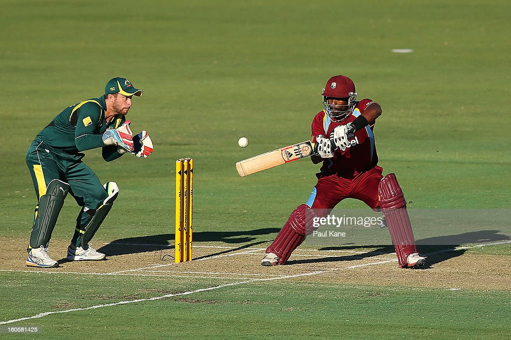 <a gi-track='captionPersonalityLinkClicked' href=/galleries/search?phrase=Dwayne+Bravo&family=editorial&specificpeople=178945 ng-click='$event.stopPropagation()'>Dwayne Bravo</a> of the West Indies edges the ball to <a gi-track='captionPersonalityLinkClicked' href=/galleries/search?phrase=Matthew+Wade&family=editorial&specificpeople=724041 ng-click='$event.stopPropagation()'>Matthew Wade</a> of Australia during game two of the Commonwealth Bank One Day International Series between Australia and the West Indies at WACA on February 3, 2013 in Perth, Australia.